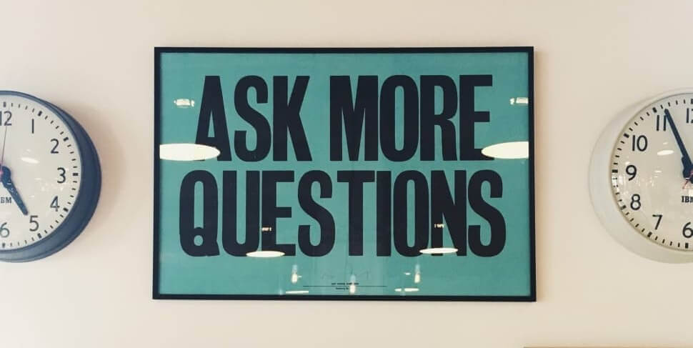 image of ask more questions sign