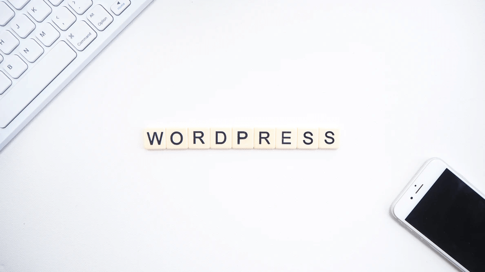 WordPress logo with phone and keyboard